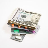 Dollar Currency and Pills — Stock Photo