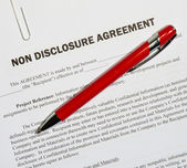 Non disclosure agreement and pen — Stock Photo