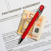 Partnership agreement forms with Euro money and pen — Stock Photo