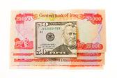 Iraqi Dinars and American Dollar — Stock Photo