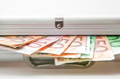 Suitcase with Euro notes showing — Stock Photo