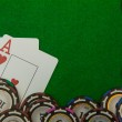 Jack and ace blackjack cards with chips on green background — Stock Photo #49396729