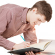 Isolated portrait of young man writing in notebook — Stock Photo