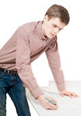 Portrait of young man working on blueprints — Stock Photo