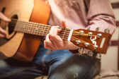 Portrait of man playing on acoustic guitar on sunny day — Stock Photo