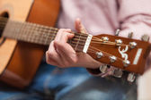 Men playing on classic wooden guitar — Stock Photo