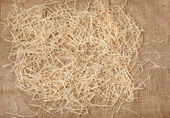 Hay lying on burlap — Stock Photo