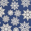 Stock Photo: Paper Cutout Snowflakes Background