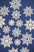 Paper Cutout Snowflakes Background — Foto Stock