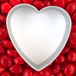 Blank heart surrounded with red candy — Stock Photo