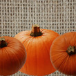 Stock Photo: Brown Burlap With Pumpkins Background