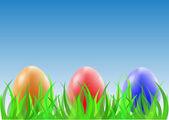 Huevos de pascua en la hierba verde — Vector de stock