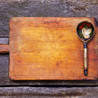 Stock Photo: Wooden spoon on old chopping board