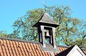 Bell tower with bell — Stock Photo