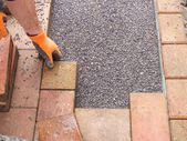 Lay paving stones — Stock Photo