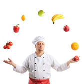 Chef juggles fruit and vegetables — Stock Photo