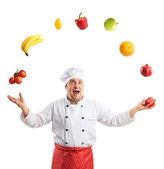 Cook si destreggia frutta e verdura — Foto Stock