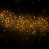 Gold glittering stars dust trail background — Stock Photo