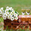 Glasses of wine and flowers — Stock Photo