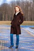 Portrait of girl in coat — Stock Photo