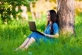 Portrait  asian girl on nature with laptop  — Stock Photo