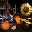 Christmas still life with wine, tangerines and hours — Stock Photo #39525323