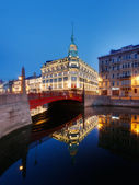 Esders & Scheefhals Trading house and Red Bridge in St. Petersburg at dawn — Stock Photo