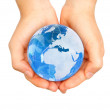 Stock Photo: World in hands
