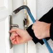 Thief breaking door — Stock Photo #40841225