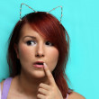 Young redhead woman with cat ears — Stock Photo