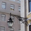 Old lantern hanging on the street of historical center of Lisbon — Stock Photo #45607427