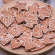 Variety of ginger-bread Christmas cookies on wooden plate — Stock Photo