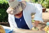 Lady prepares Pinacolada — Stock Photo