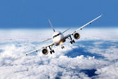 Plane above the clouds — Stock Photo