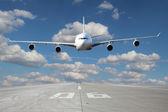 Low pass of white plane — Stock Photo