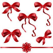 Big set of red gift bows with ribbons — Stockvektor