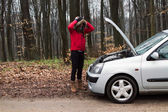 Young women with Damaged Car — Stock Photo