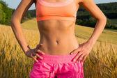 Schöne und muskel läufer magen — Stockfoto