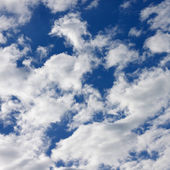 Clouds in the bright sunny blue sky — Stock Photo