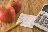 Nutrition information, an apple and a calculator — Stock Photo