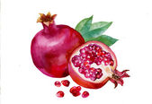 Pomegranates with green leaves — Stockfoto