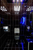 Black bathroom with blue backlight  — Stock Photo
