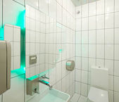 White bathroom with aqua backlight — Stock Photo