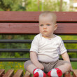 Young adorable cheerful baby sit in park — Stock Photo #41759445