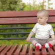 Stock Photo: Young adorable cheerful baby sit in park
