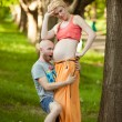 Happy and young pregnant couple hugging in nature, new life conc — Stock Photo #42874981