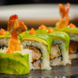 Organic sushi roll with shrimp tempura at restaurant — Stock Photo #43979949