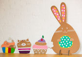Rabbit made from organic paper on a white wall. Decoration — Stock Photo
