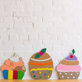 Colored cakes handmade of paper on white background — Photo