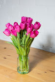 Beautiful pink tulips in a vase — Stock fotografie